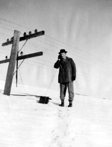 photo credit: Omaha World-Herald J.J. Ganney of Ashby, Neb., scaled this huge snowbank in January 1949 and used portable equipment to patch into telephone lines.